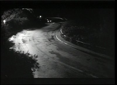 stock-footage-cars-driving-down-country-road-at-night